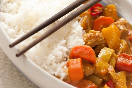Delicious pork curry served with hot Thai jasmine rice photo
