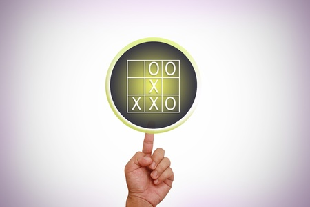 Hand pointing on O and X table Stock Photo - 12992857