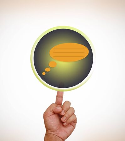 Hand pointing on speech balloon photo
