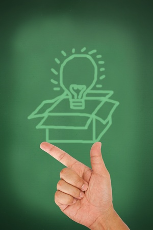 Hand pointing on think out of the box on blackboard Stock Photo - 13076836