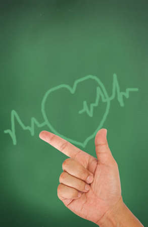 Hand pointing on heart and pulse Stock Photo - 13076967