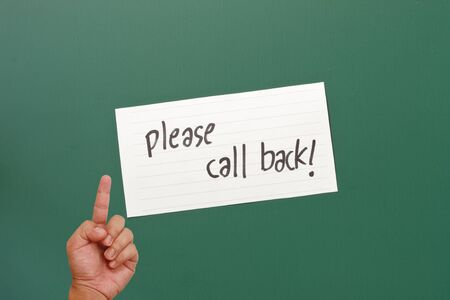 Hand pointing on please call back paper Stock Photo