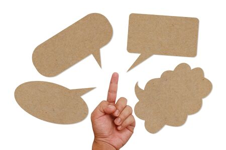 Hand pointing on blank brown paper speech balloon Stock Photo - 13209734