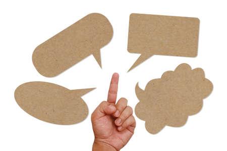 Hand pointing on paper speech balloon Stock Photo - 13209860
