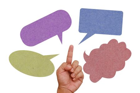 Hand pointing on color paper texture speech balloon photo