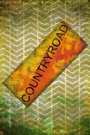 Countryroad sign plate on tyre grunge background photo