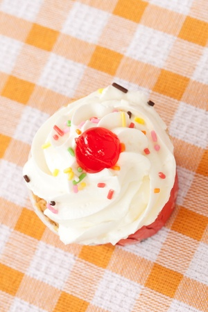 Cup vanilla cake with topping Stock Photo - 13495864