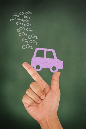Hand hold car with carbon dioxide photo