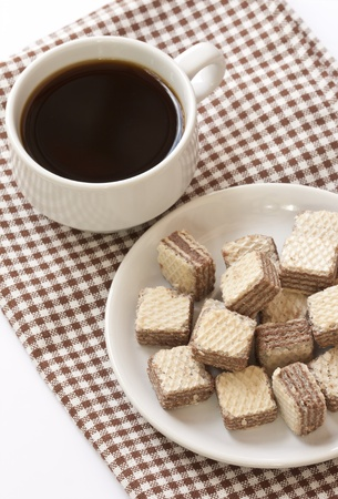 Chocolate wafer cookies with black coffee photo