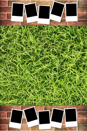 Photo frame with on grunge brick wall and green grass background photo