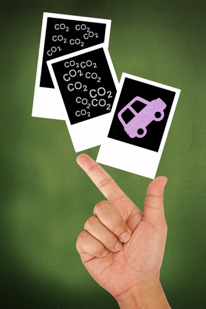 Hand hold car release carbon dioxide emission Stock Photo