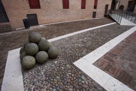 Stone group at Castello Estense castle in Ferrara, Italy