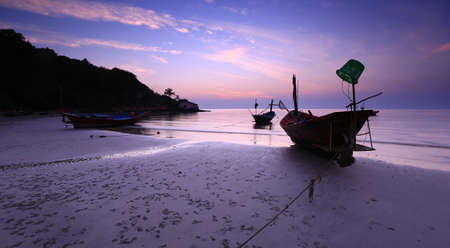Boat on the beach in the evening