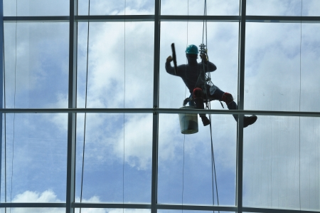 window washer: A window washer on a skyscraper