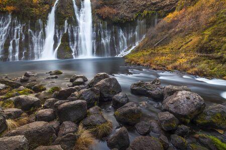 rushing water: Water rushing down the falls