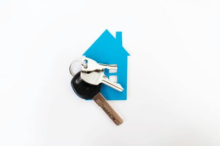 house with keys on a white background. home purchase and mortgage. keys for a new house.