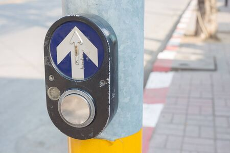 Press the button to cross the street.