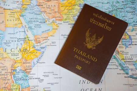 Thai passport and world travel map