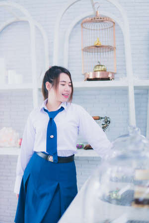 School uniform girl in a coffee shop