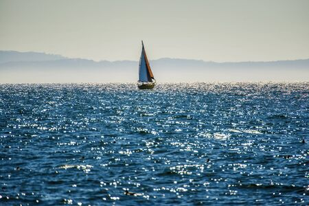 Lonely sail boat in the sea 写真素材