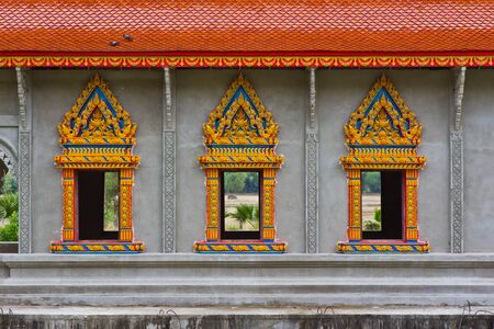 Windows of the temple in Thailand photo
