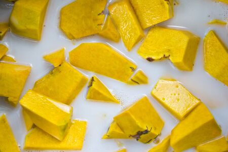 Thai style dessert, pumpkin in coconut milk photo