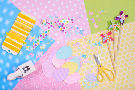 paper punch: Colorful accessories for craft, scissors, paper, ribbon, punch, egg shapes, view from above