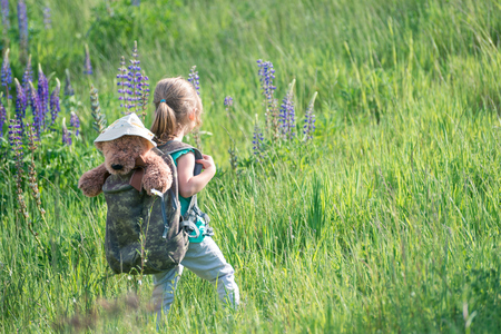 This little explorer is always with her best friend teddy bear - it