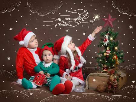 especially: Children believe in miracles and magic - especially on Christmas night. Stock Photo