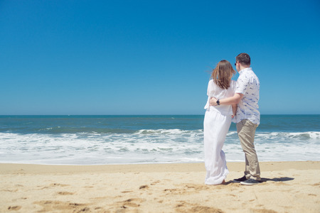 average guy: Young romantic couple hugging on the beach