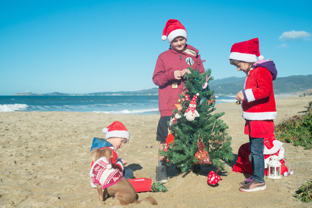 christmas at the beach with three kids and a dog stock photo 91591089 - Christmas At The Beach