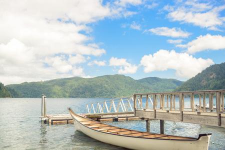 Wooden boat pier on mountain lake