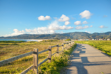 Beautiful scenic road on the green bluff above the ocean beach