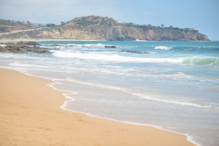 Beautiful sandy beach and waves in the ocean