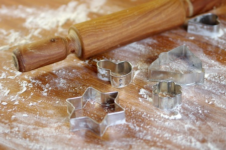 Cookie cutters and flour on the table photo
