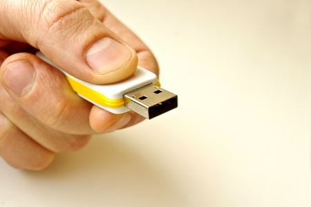 USB computer memory stick in a hand Stock Photo - 8505236