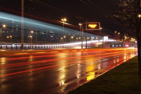 car lights: Fast moving cars at night