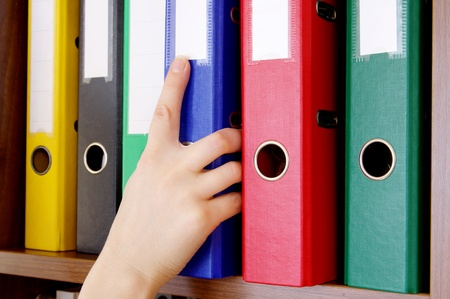 archival: Folder with archival documents and a hand