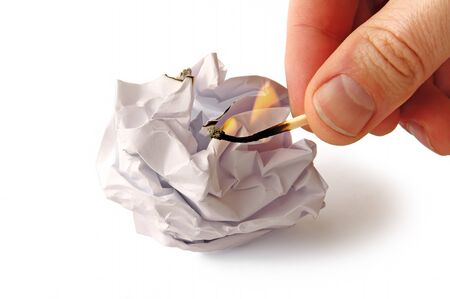 rumple: Man is trying to burn Crumpled paper isolated on white