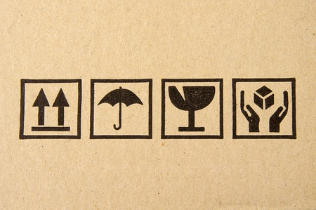 carton: Primer plano de la imagen de s�mbolo fr�gil grunge negro sobre cartulina