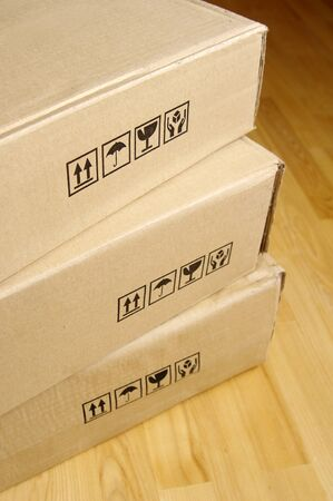 Brown cardboard boxes arranged in stack  photo