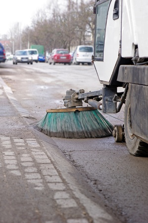 A sweeping machine cleans the street  Stock Photo