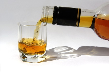 whiskey being poured into a glass  Stock Photo - 9276816