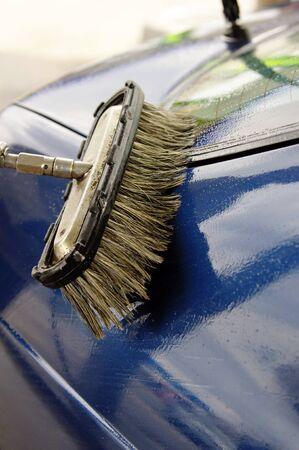 Washing Car with Scrub Brush photo