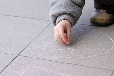 Girl drawing with chalk photo