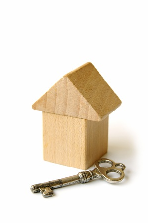 forsale: The Wooden House And Key Stock Photo