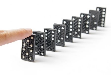 Line of dominos and finger Stock Photo - 9736586