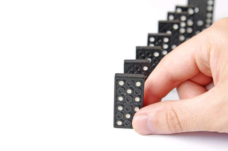 Line of dominos and hand Stock Photo - 9736587
