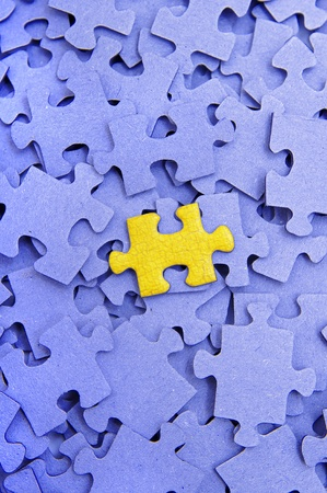 Blue puzzle with one yellow element  photo