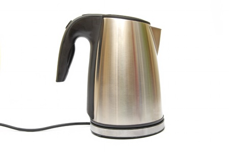 Shiny kettle isolated on the white background  photo